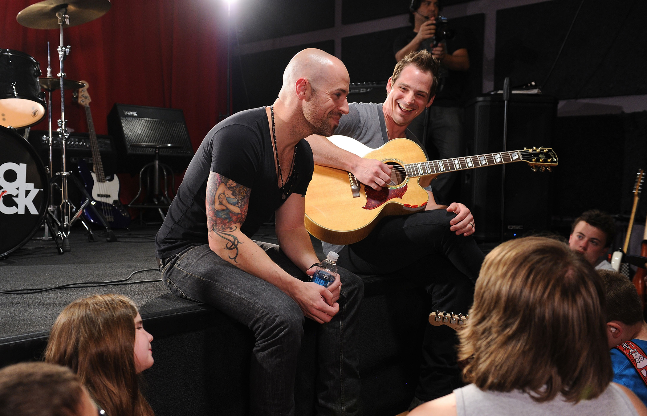 Chris Daughtry and bandmate Brian Craddock at the School of Rock on July 19, 2012 in Tenafly, New Jersey.