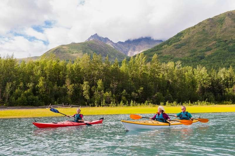 Recreational kayak touring in Eklutna Lake, Chugach State Park, Alaska