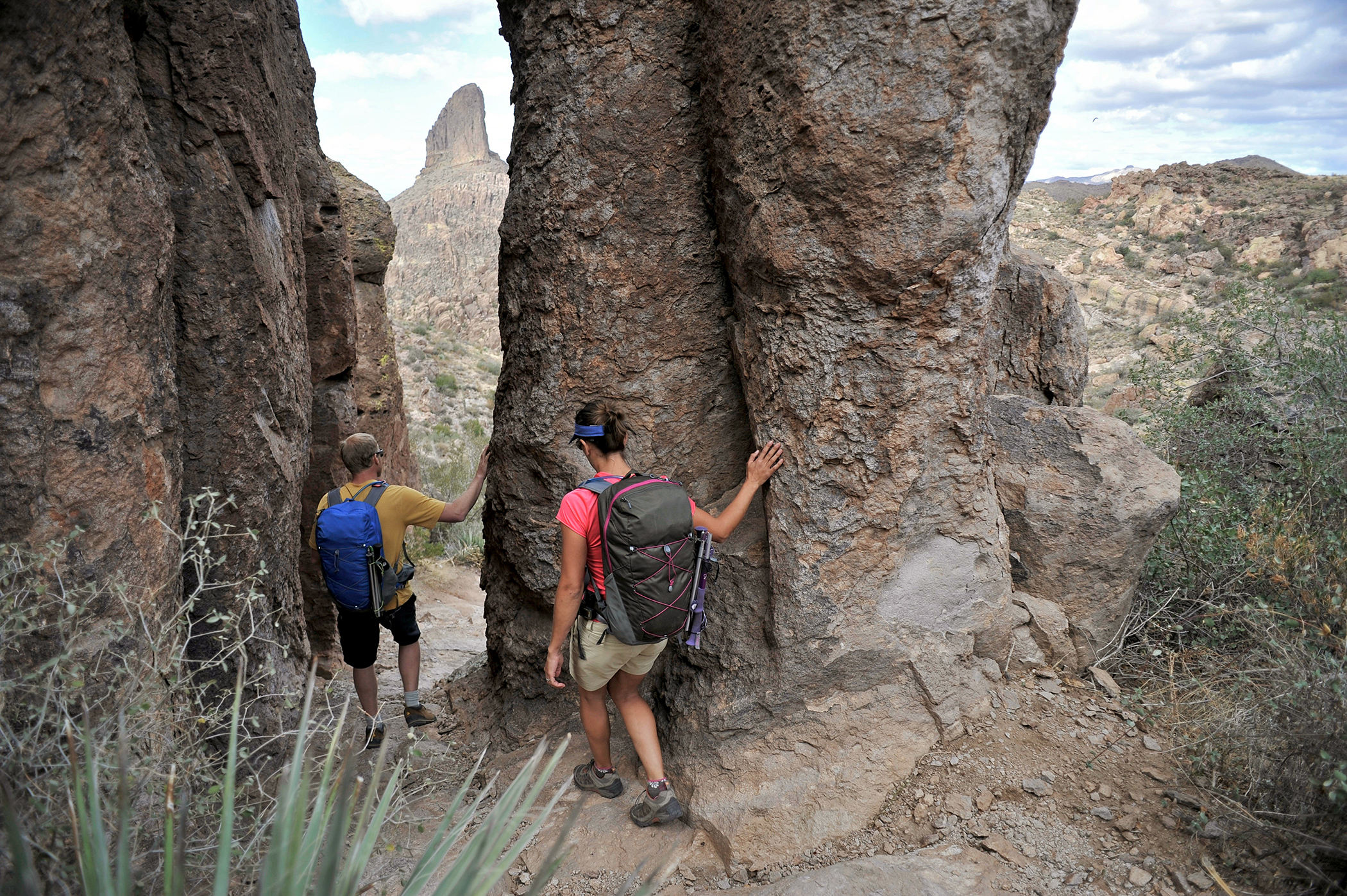 Hikers on the Fremont Saddle on the popular Peralta Trail in the Superstition Wilderness Area, Tonto National Forest near Mesa, Arizona