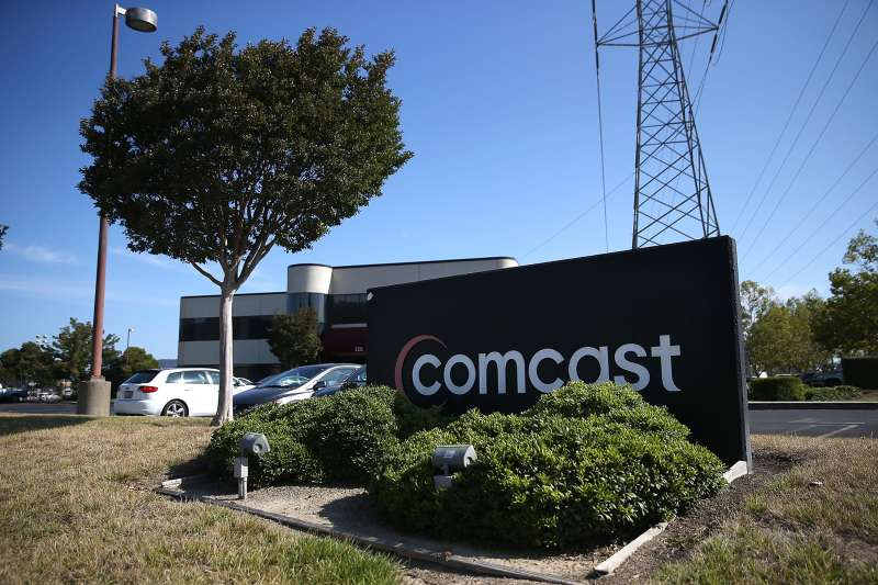 A sign is posted in front of a Comcast service center on July 13, 2015 in San Rafael, California.