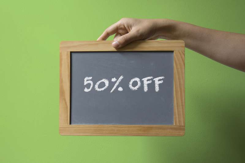 hand holding chalkboard that reads: 50% off