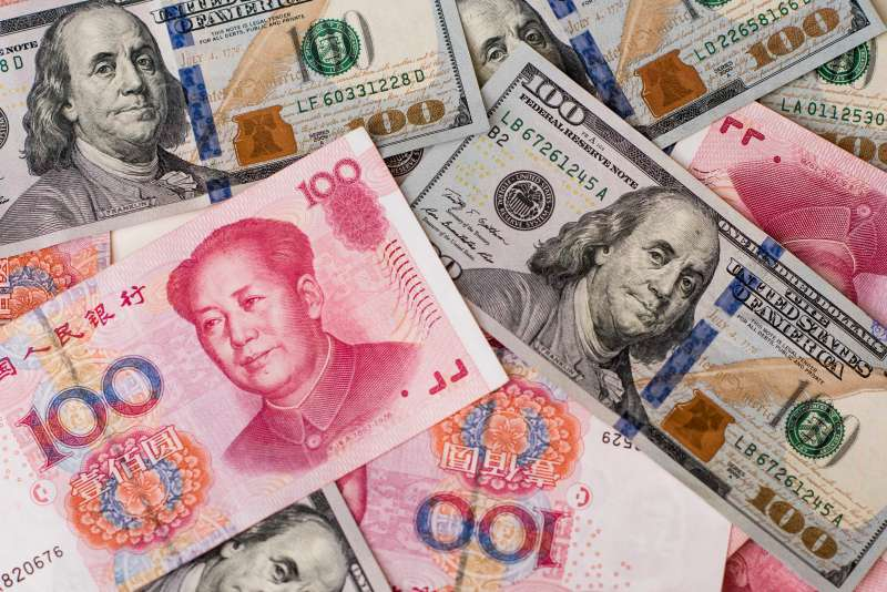 Yuan And Dollar Banknotes Ahead Of Tenth Anniversary Of China's Yuan Reform