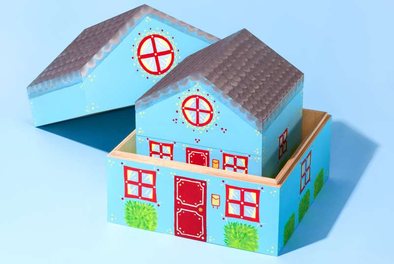 Toy wooden house within a house