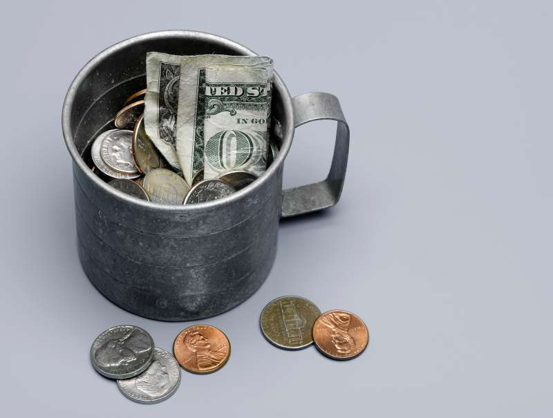 tin cup with money