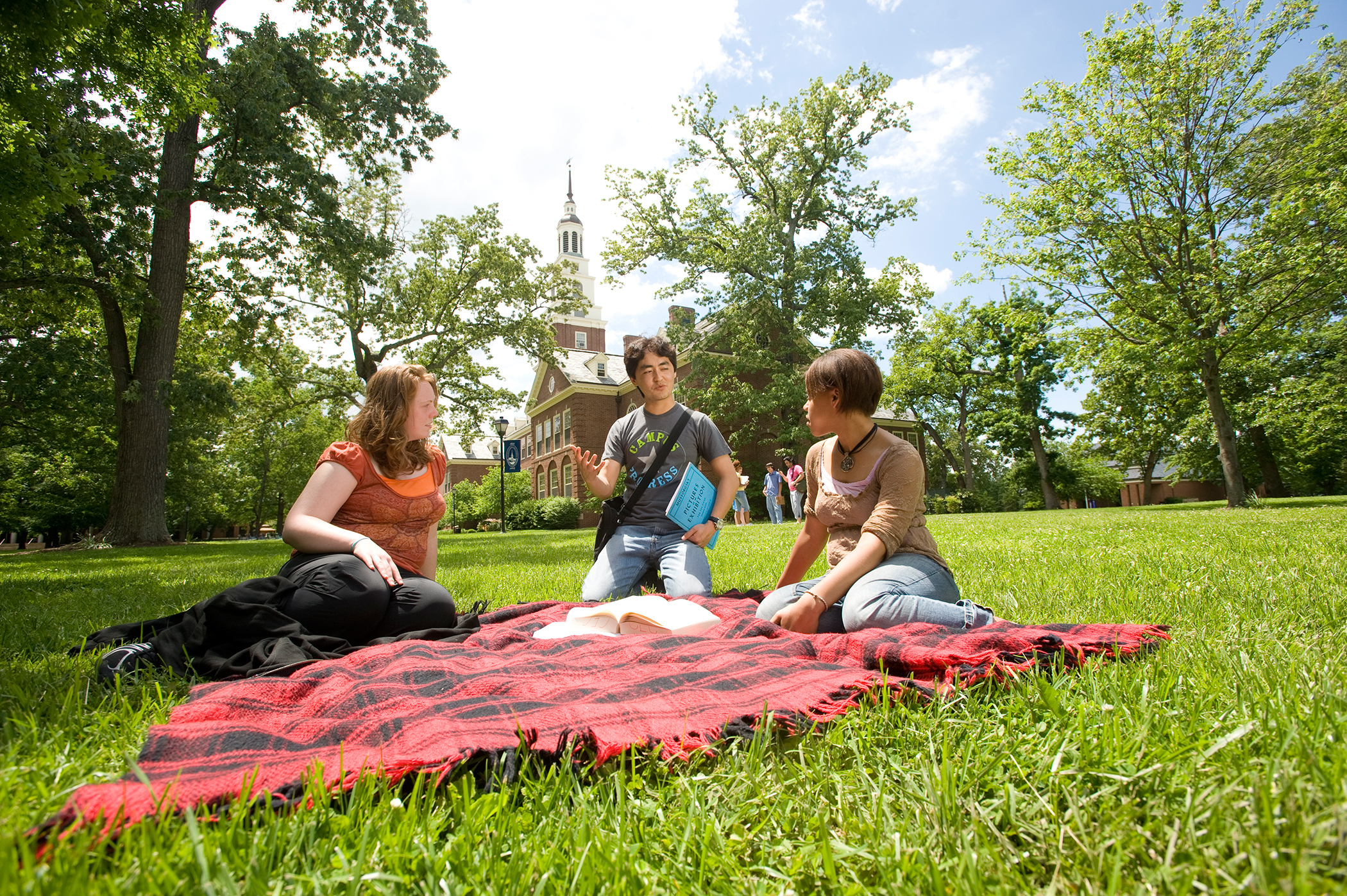 Students Jessica Puckett-Davis, Ahmad Shuja, and Keosha Morgan study outside of Draper on a nice Spring day, Berea College, May 22, 2009.