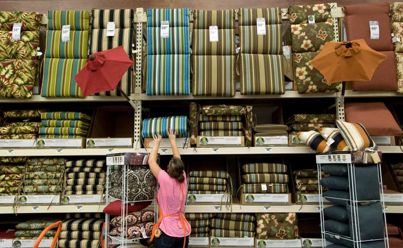 Associate Brittani Spickelmior keeps the patio furniture cushions stocked at the expanded Home Depot, in Anaheim Hills, California, 2012