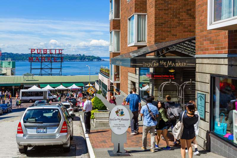 View down Pine Street of Pike Place Market with Inn at the Market in foreground, Seattle