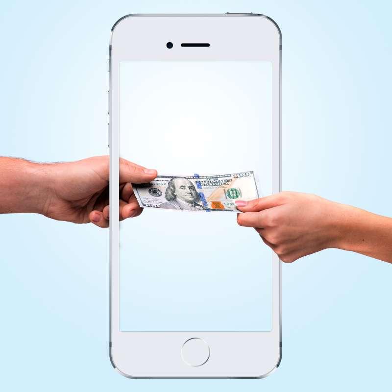 hand passing money through iPhone 6 frame