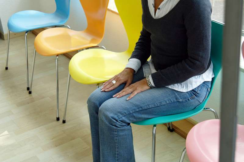 woman in waiting room chairs