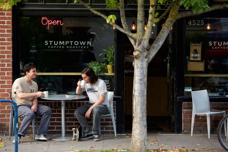 Danny and Donny Johnson of Portland, Oregon drink coffee outside of Stumptown Coffee Roasters on October 6, 2015 in Portland, Oregon.