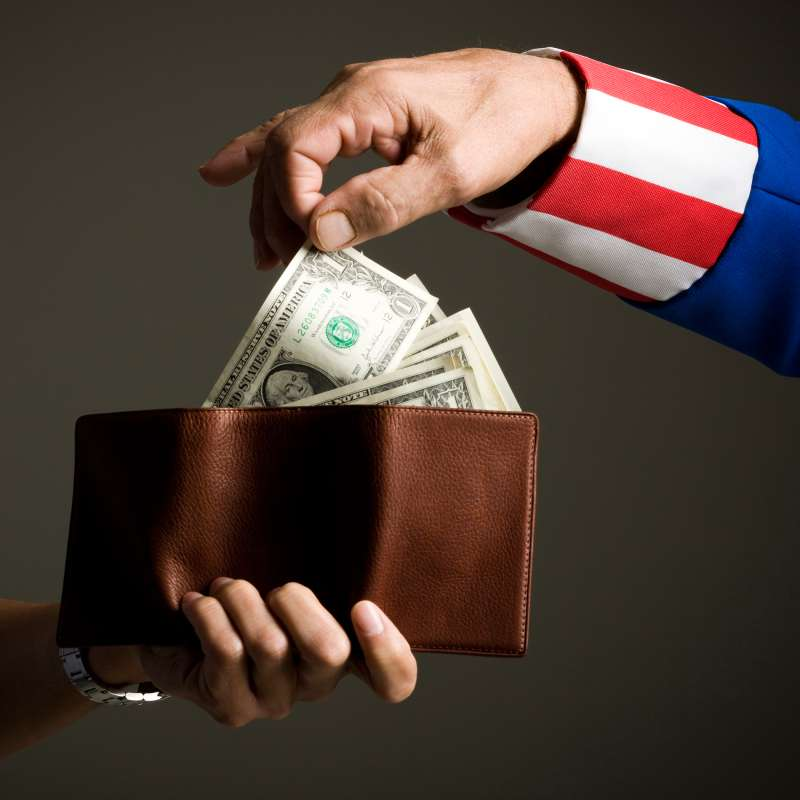 uncle sam taking money out of wallet