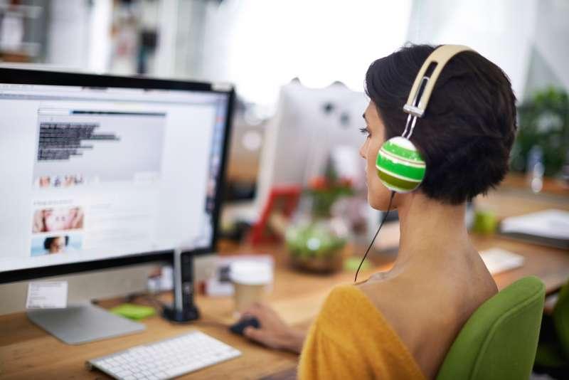 woman wearing headphones in office