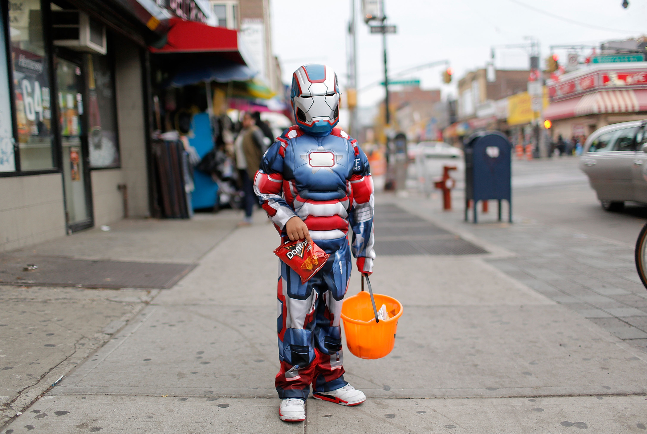 Ethan  of Bedford-Stuyvesant poses for a photo as he  Trick or Treats  in Bedford-Stuyvesant, Brooklyn on October 31, 2013 in New York City.