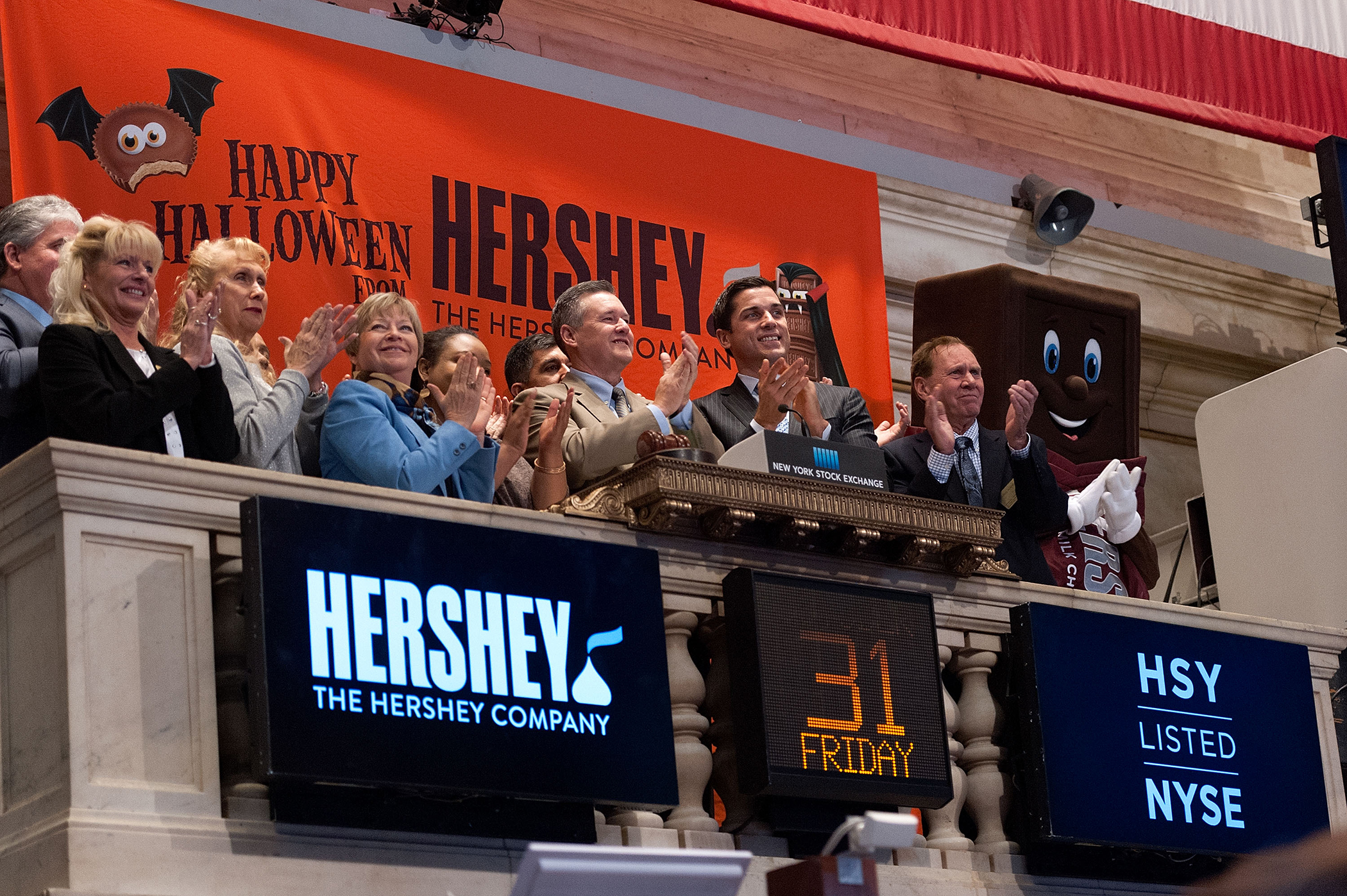 The Hershey Company president and CEO J.P. Bilbrey (C) rings the NYSE Opening Bell at the New York Stock Exchange on October 31, 2014 in New York City.