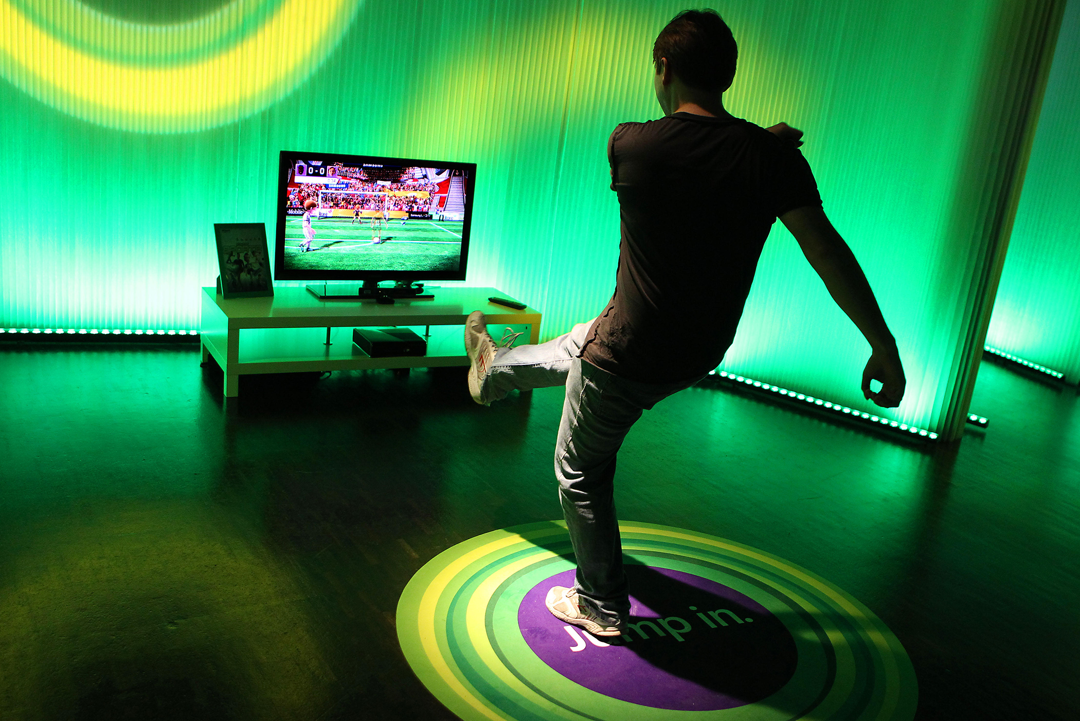 A man checks out Microsoft's new Xbox 360 equipped with 'Kinect' kinetic controller at the Gamescom trade fair in Cologne, Germany, on August 17, 2010.