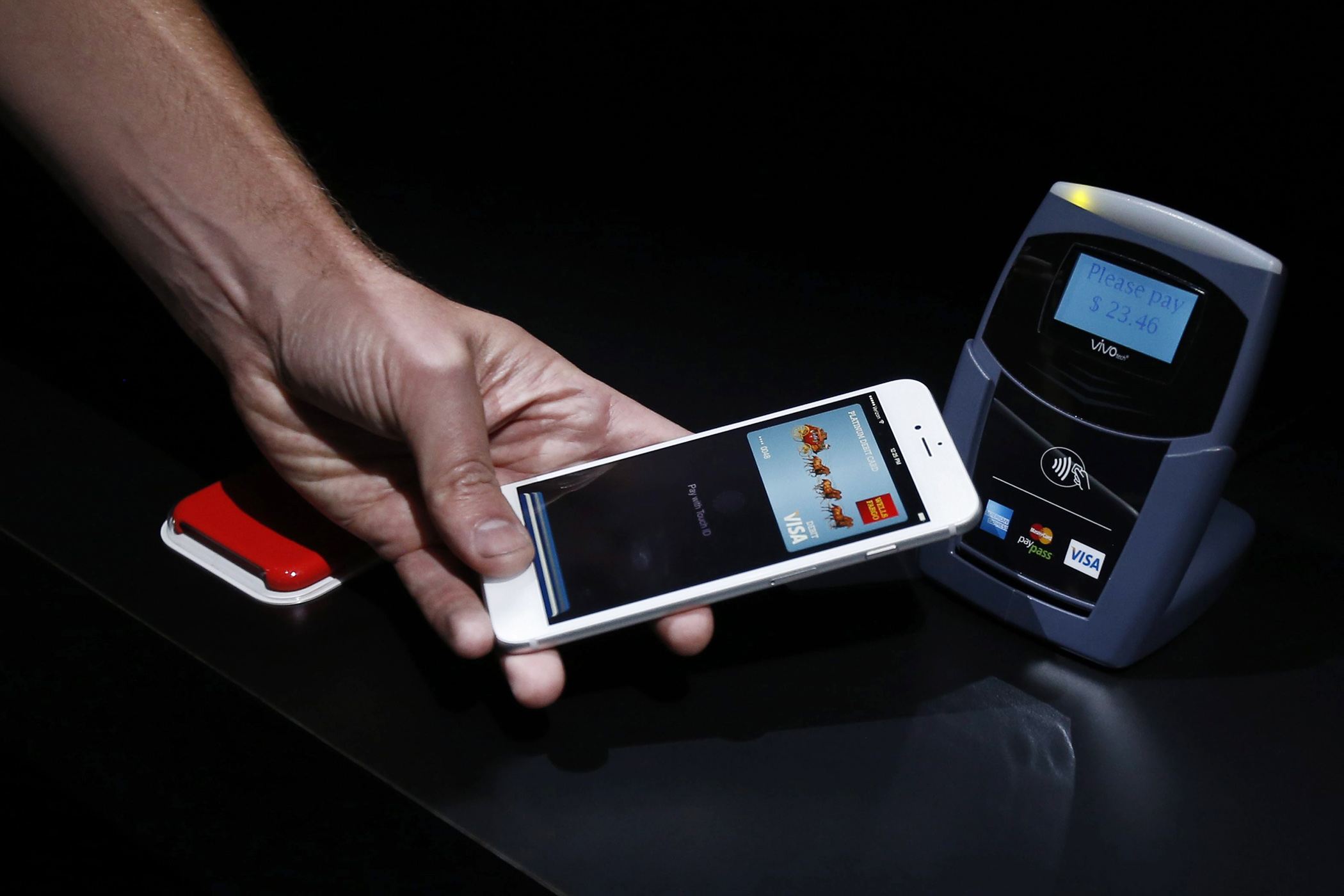 Demonstration on how the new Apple Pay works during Apple's launch event at the Flint Center for the Performing Arts in Cupertino, California, September 9, 2014.