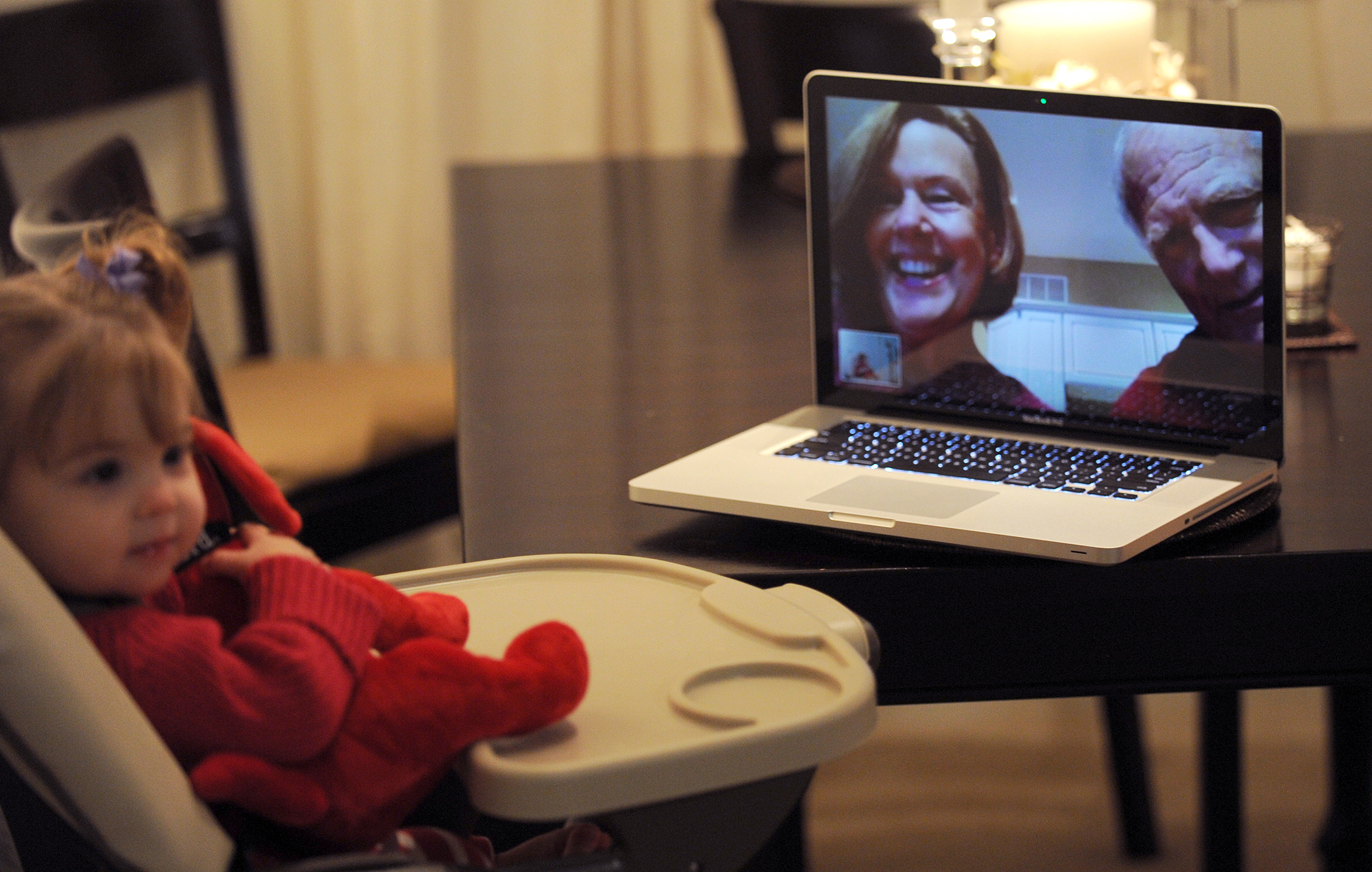 Thirteen-month old Emma Joyce of Hingham, Massachusetts use Skype to visit her grandparents, Don and Jane McClain who live in Dayton, Ohio. Emma's parents are Brian and Allison Joyce.
