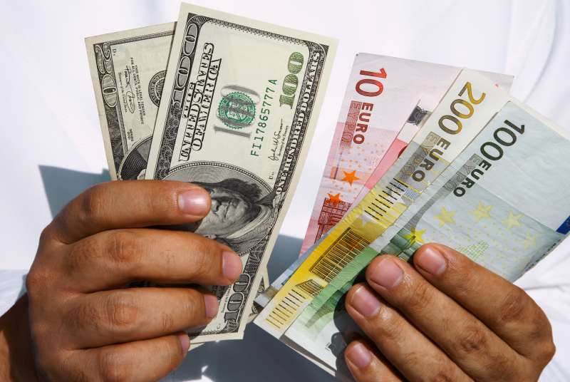 hands holding dollars and euros