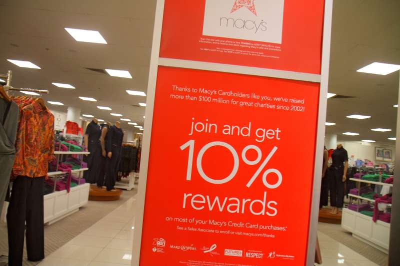 A 2014 promotional poster for a Macy's department store credit is shown in the Miami store.