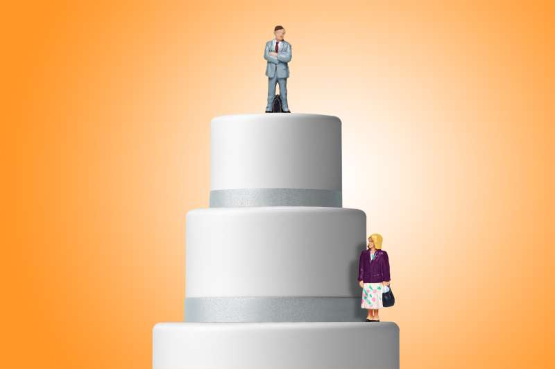 cake with businessman on top tier and businesswoman on lower tier