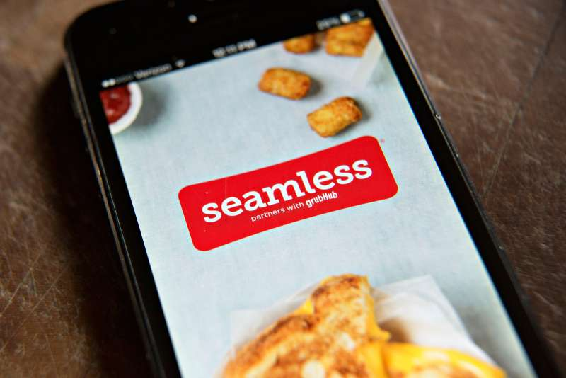 The Seamless app is displayed on an Apple Inc. iPhone 5 in Tiskilwa, Illinois, on April 2, 2014.