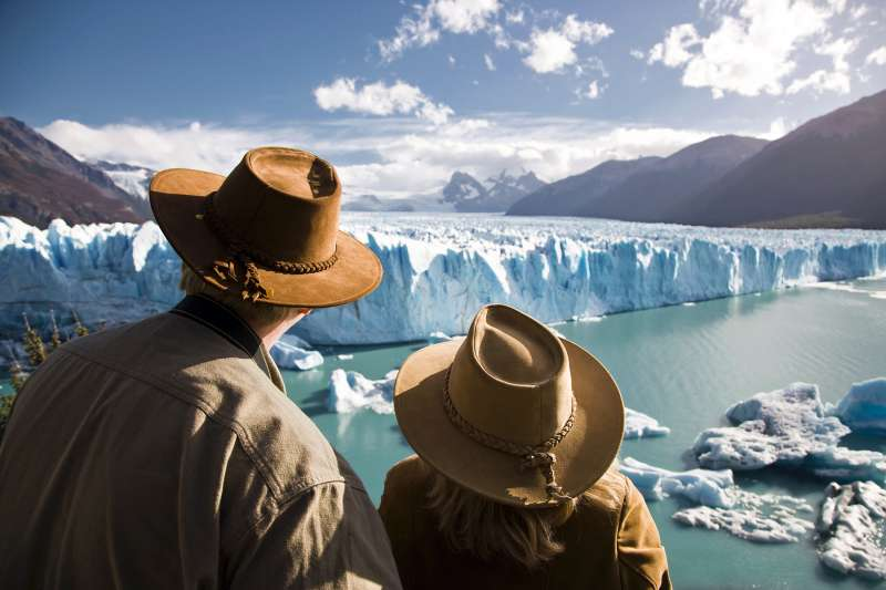 mature couple looking at glaciers