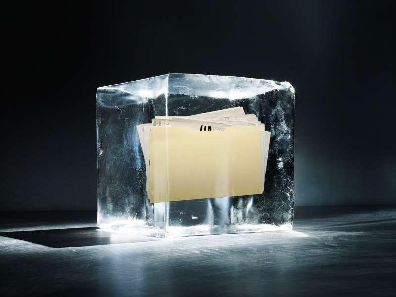 manilla folder inside block of ice