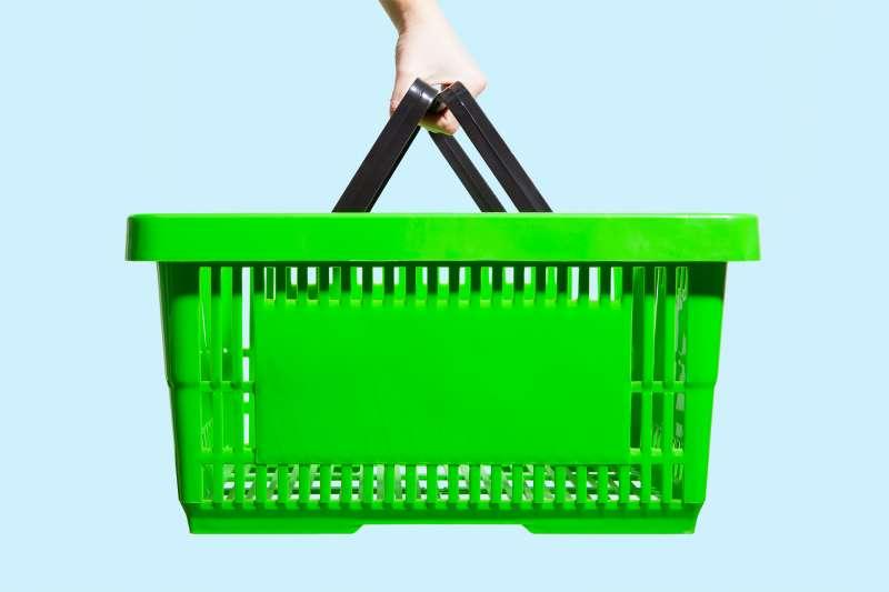 hand holding shopping basket
