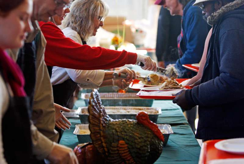 Volunteers help serve Thanksgiving meals during the 22nd annual Thanksgiving Day dinner hosted by St. Peter's Catholic Church and First Baptist Church of Columbia in Columbia, South Carolina, November 22, 2012.