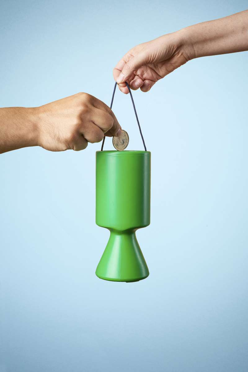 putting money in charity container