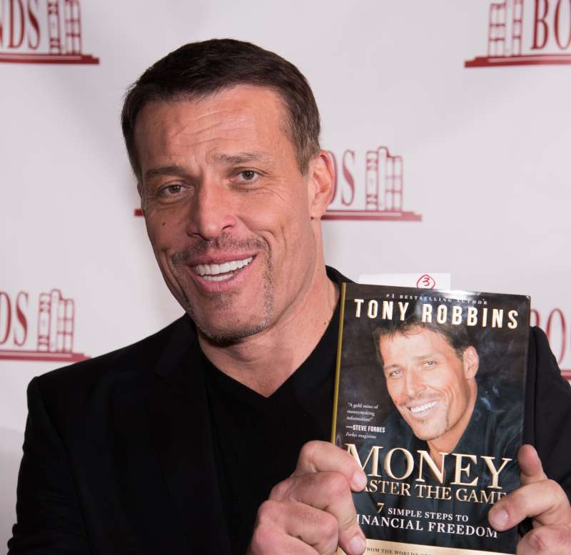 Tony Robbins Signs Copies Of His Book  Money: Master Of The Game
