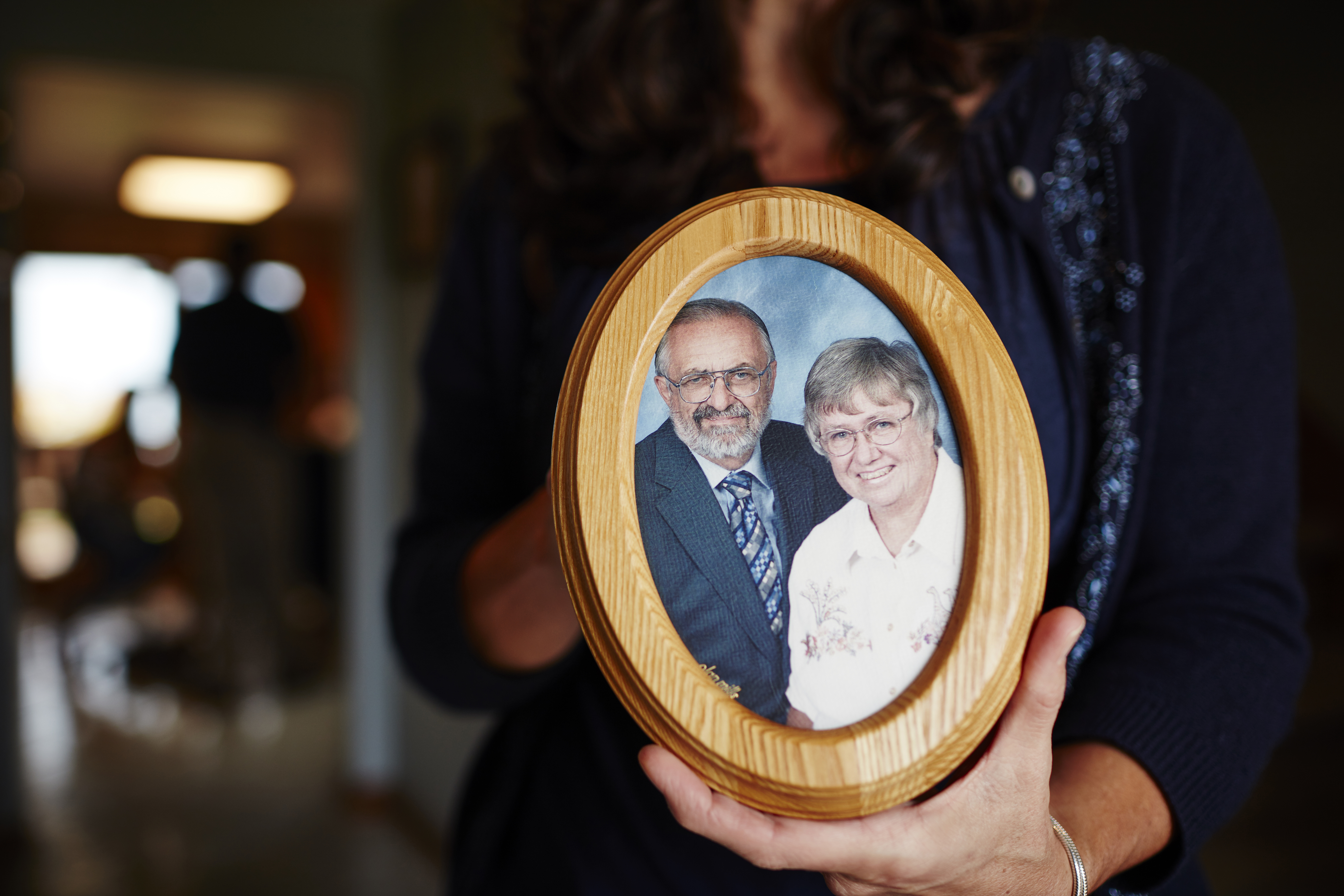 Theresa Von Vreckin holds a photo of her parents