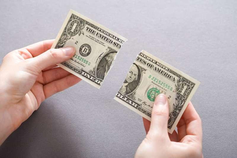 dollar bill torn in half