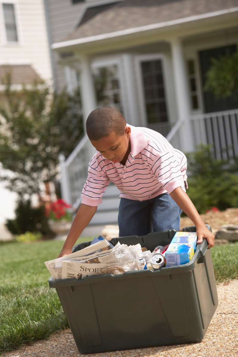 kid taking out recycling