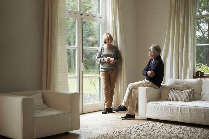 senior couple in living room