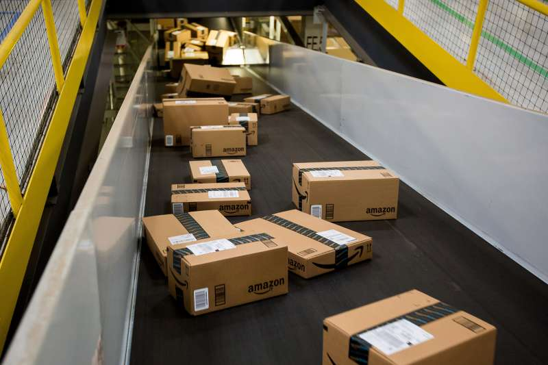 Boxes move along a conveyor belt at the Amazon.com fulfillment center on Cyber Monday in Robbinsville, New Jersey, on November 30, 2015.