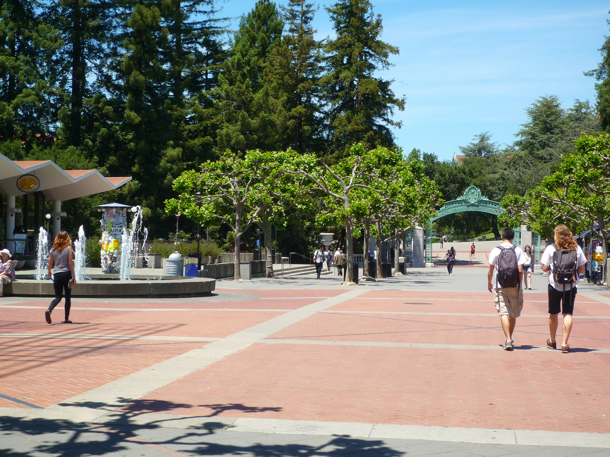 Students walking on Sproul Plaza, Sather Gate in back, University of California-Berkeley