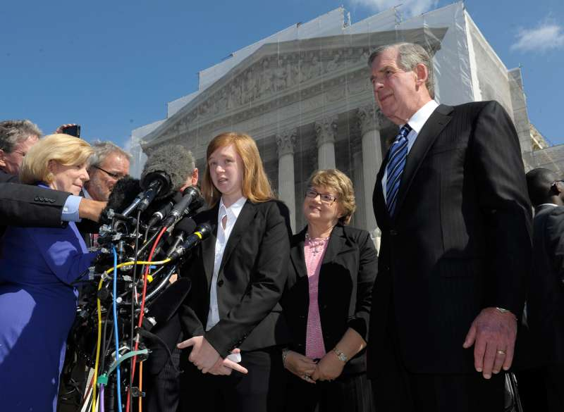 Abigail Fisher, the Texan involved in the University of Texas affirmative action case, accompanied by her attorney Bert Rein, right, spoke to reporters outside the Supreme Court in Washington in October 2012.