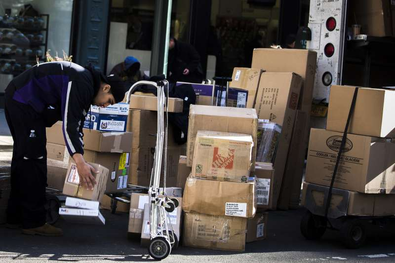 A FedEx employee sorts packages for delivery in Midtown New York, on December 4, 2015.