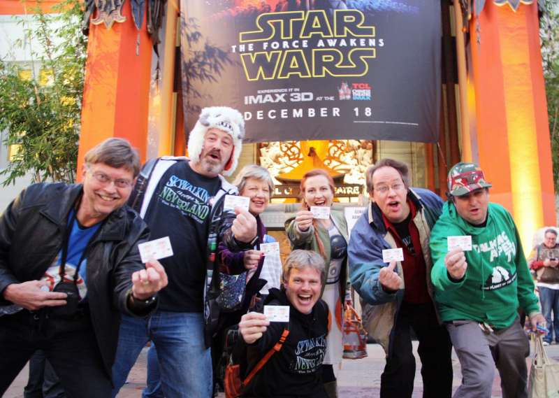 People show their tickets for the new movie in the Star Wars franchise,  The Force Awakens,  in front of a Hollywood movie theater in Los Angeles on Dec. 17, 2015, the release day of the film in the United States.