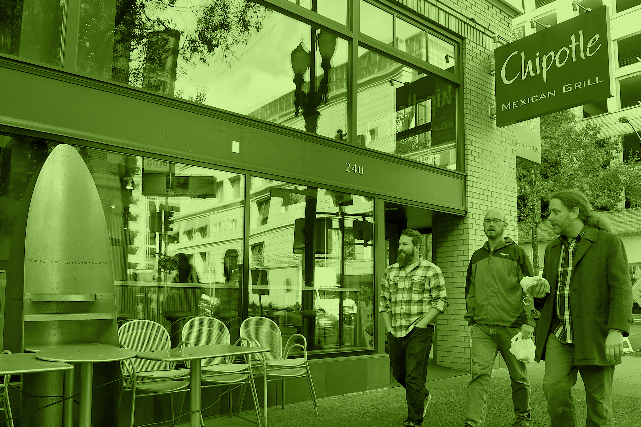 People walk past a Chipotle Mexican Grill store location in downtown Portland on November 3, 2015 in Portland, Oregon.