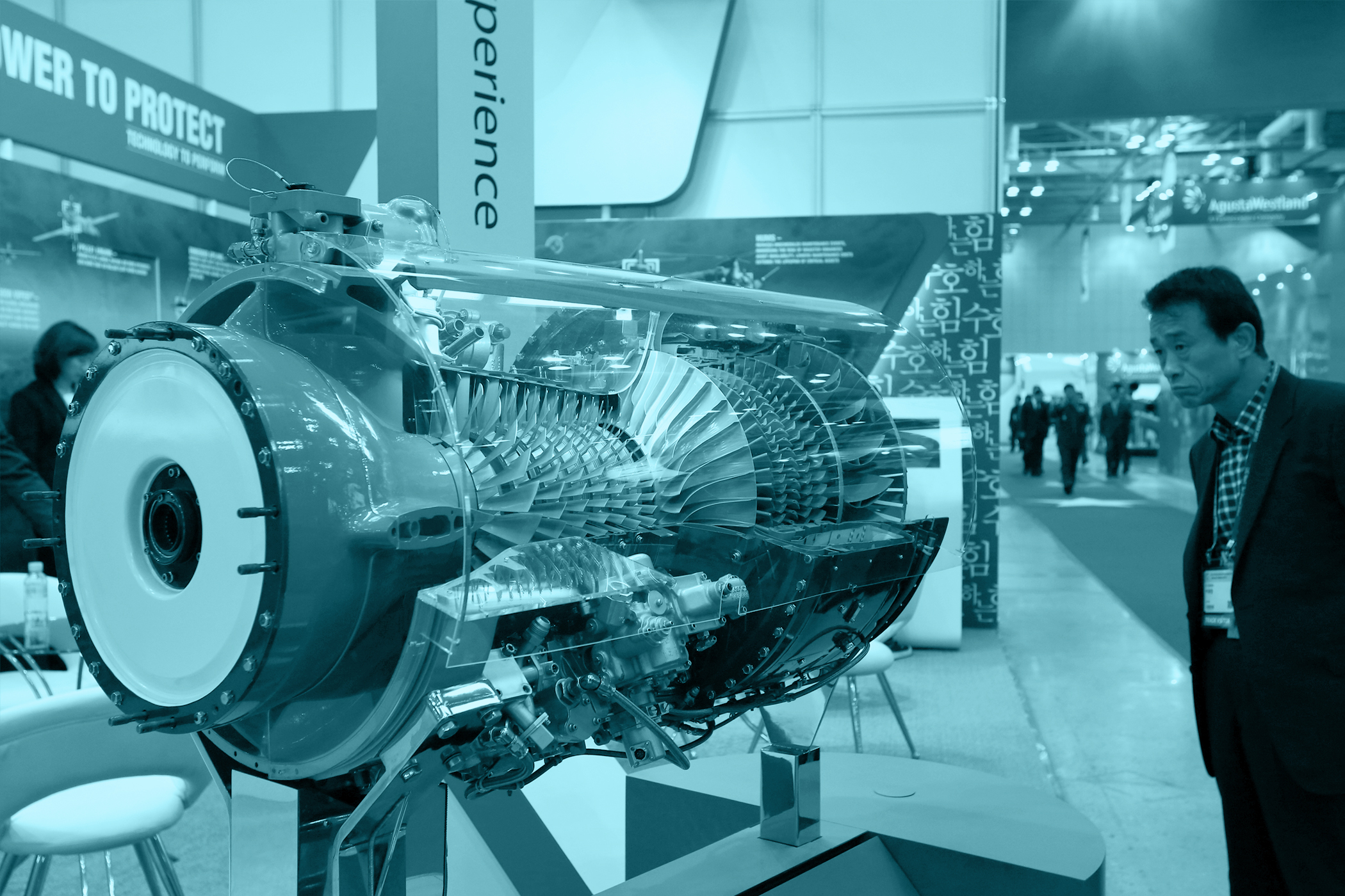 A visitor looks at a model of the Honeywell Aerospace T55 engine at the Seoul International Aerospace & Defense Exhibition 2013 in Goyang, South Korea, on October 29, 2013.