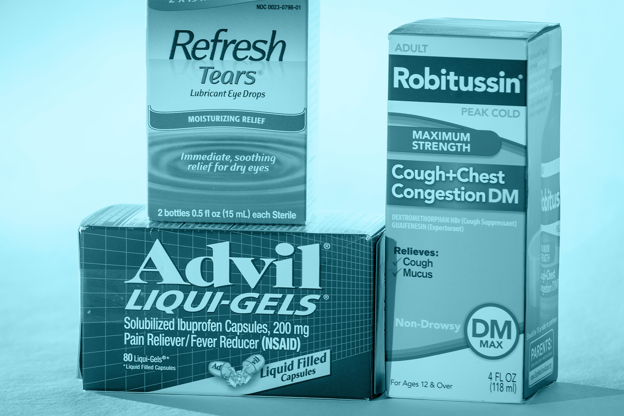 Pfizer drugs Advil and Robitussin, and Allergan's Refresh eye drops are pictured in this photo illustration in the Manhattan borough of New York October 29, 2015.