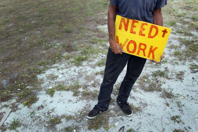 Stephen Greene works a street corner hoping to land a job as a laborer or carpenter on June 3, 2011 in Pompano Beach, Florida during the Great Recession.