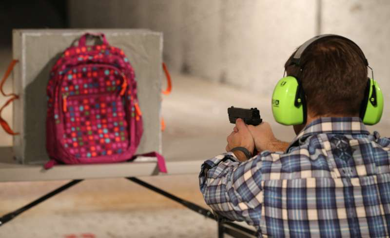 Chief Operating Officer for Amendment II, Rich Brand, shoots a child's backpack with their Rynohide CNT Shield in it
