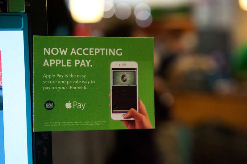 Apple Pay is promoted on signs placed at the cash register of Whole Foods in Columbus Circle on October 20, 2014 in New York, NY. T