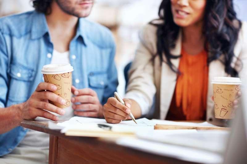 coworkers having coffee in coffee shop