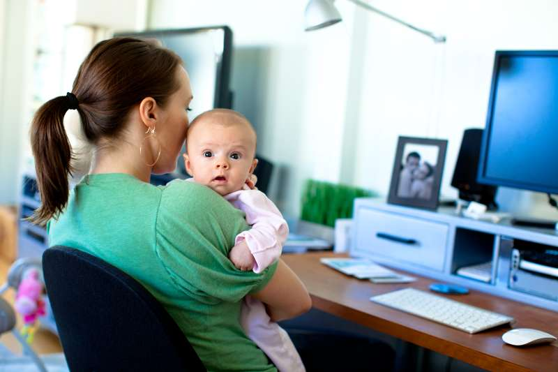 mom with baby working at home