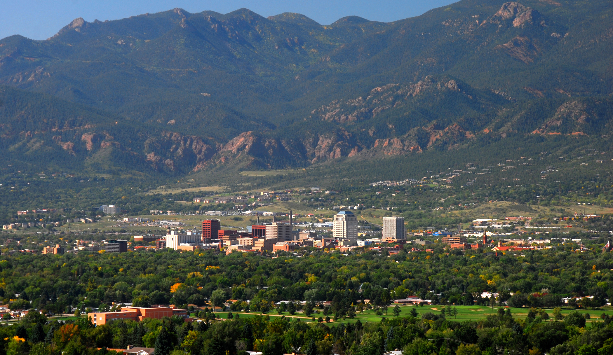 Downtown Colorado Springs, Colorado as seen from Palmer Park, set against the front range of the Majestic Rocky Mountains.