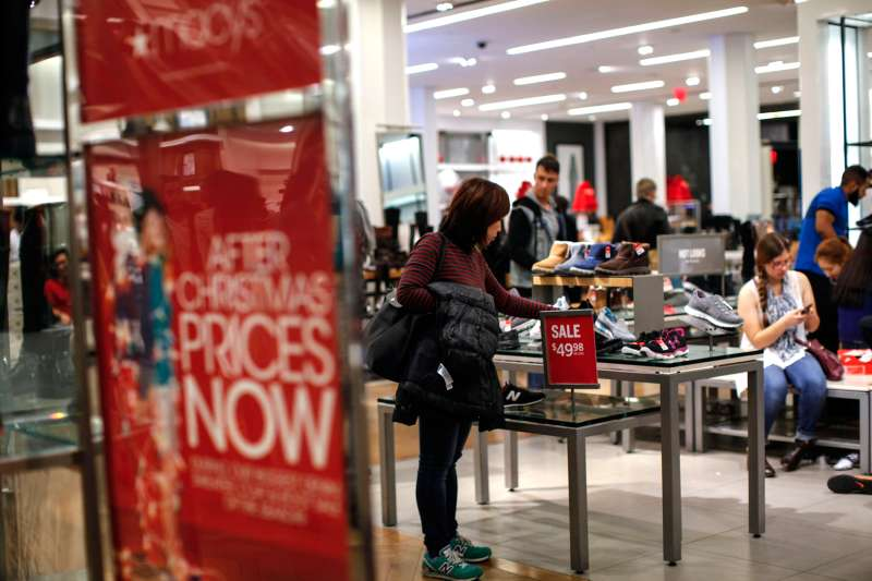 A woman looks for shoes at a Macy's store on December 24, 2015 in New York City.